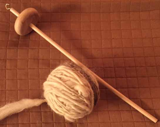 Yarn I made during a drop spindle workshop at the Texas Living History Association meeting. Not terribly pretty. I will need many hours to get good at it.