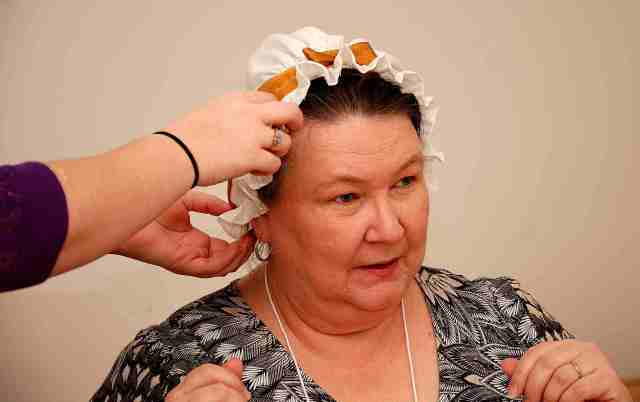Deanna Berkemeier gets a cap fitting at the 18th Century Cap workshop
