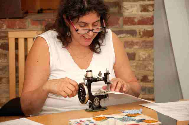 Helena Cora Moran participating in the Early Sewing Machine workshop. Helena is also a volunteer at HSMC and helped set up and take down the machines for the workshop.