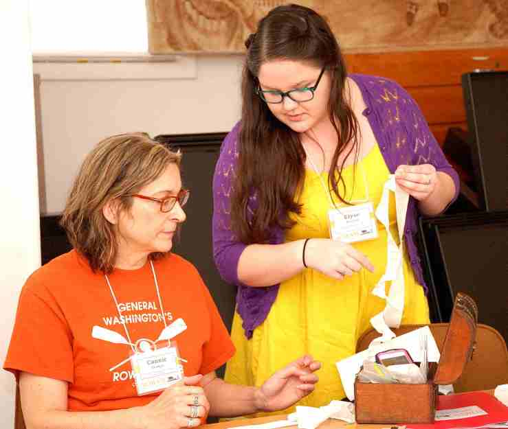 "Connie Unangst and Elyse Bennett work on ruffles during the ""Making an 18th Century Cap"" workshop"