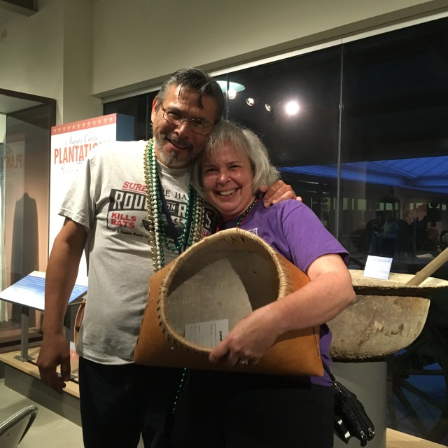 Karen Clancy was the happy winner of the birch bark basket made by Del Taylor