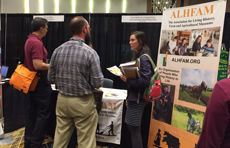 Jon Kuester, ALHFAM member and MOMCC board member, chats with visitors to the booth.